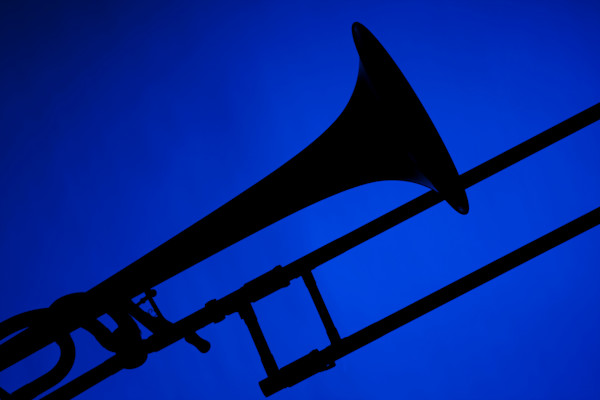 Trombone Silhouette Isolated on Blue 2608.44