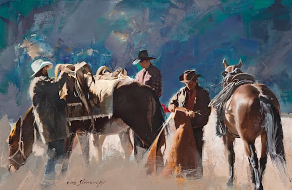 Three cowboys saddling up