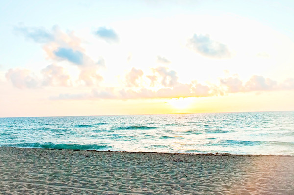 Yellow Sunrise and Blue Waves in the Morning at the Beach in Fort Lauderdale