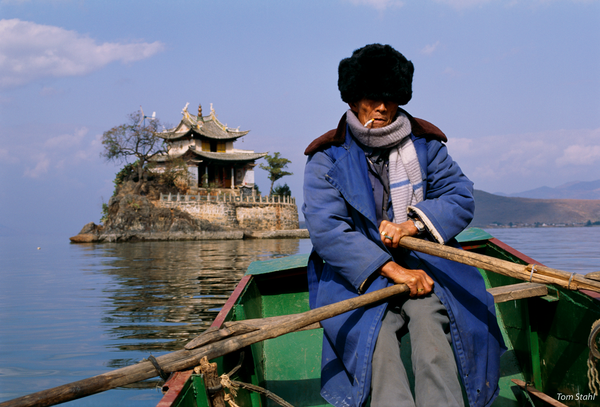 Rowing to temple, Dai Lake, China, 1992.