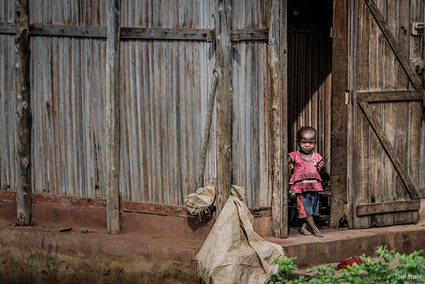 Girl in a doorway, Nosy Be, Madagascar, 2019.
