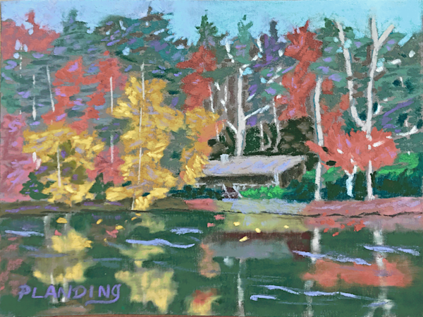 """""""Music in the Trees"""" is an original soft pastel painting showing the Brevard Music Center on its lake, surrounded by fall foliage."""