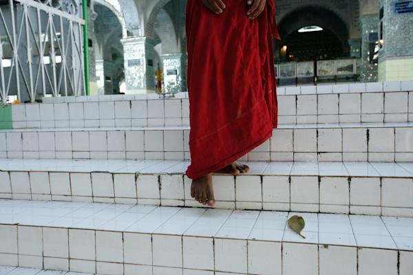 monk red robe white stairs Mandalay Buddhist Su Taung Pyae Pagoda temple