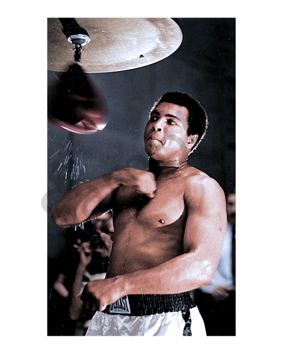 Muhammad Ali practicing on a punching bag