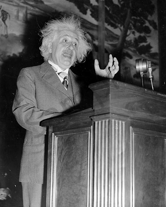 Albert Einstein on a podium