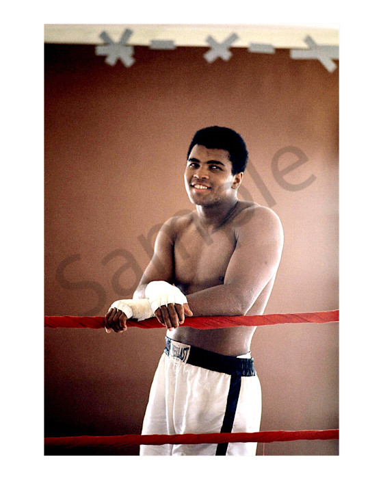Muhammad Ali posing in a boxing ring, color