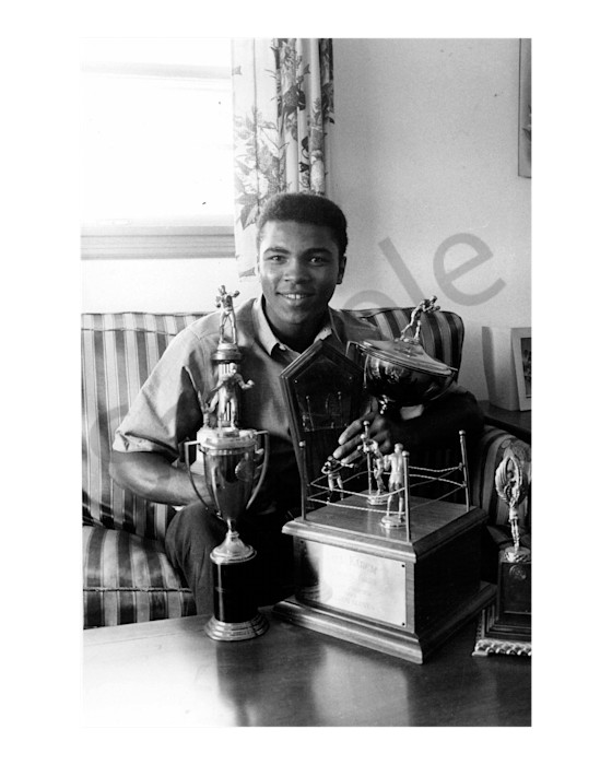 Muhammad Ali with his trophies