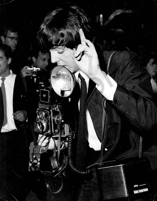 Paul McCartney taking a photo