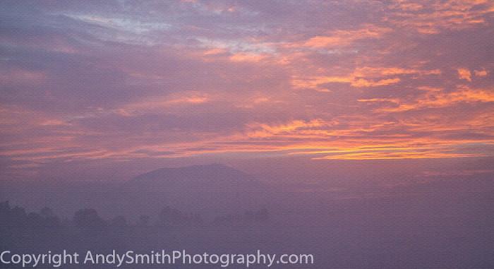 fine art photograph of sunrise glow on misty morning at San Felipe del Progreso