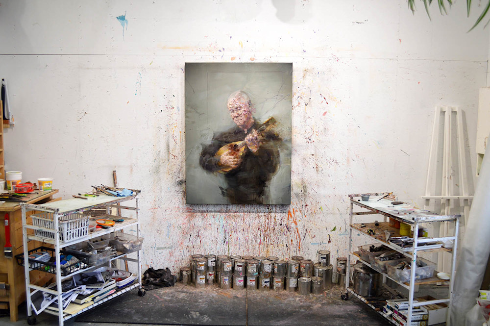 Jean with mandolin painting in the studio