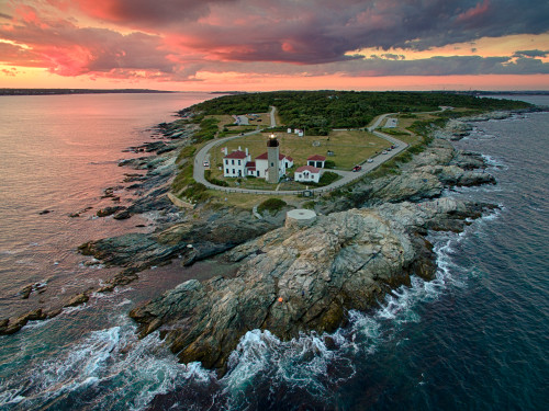 Beavertail lighthouse sunset aerial 2 ujf59n
