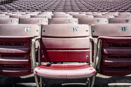 10_11_12_13_14_numbers_stadium_seat_red_close_up_number_badge_beat_up_rivets_black_number_arena_sports_football_pro_college_ncaa_jfl_baseball_soccer_seat_down_numeral_aisle_row_angle_front_view_horizontal_view_section_c68l6g