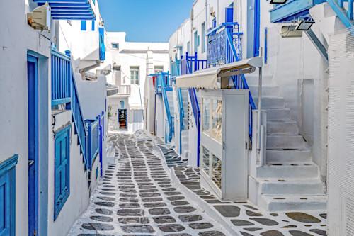 Blues and narrow street in mykonos ii greece udx7fg