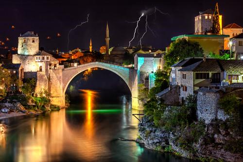 Mostar bosnia and bridge during lightning storm wnuolr