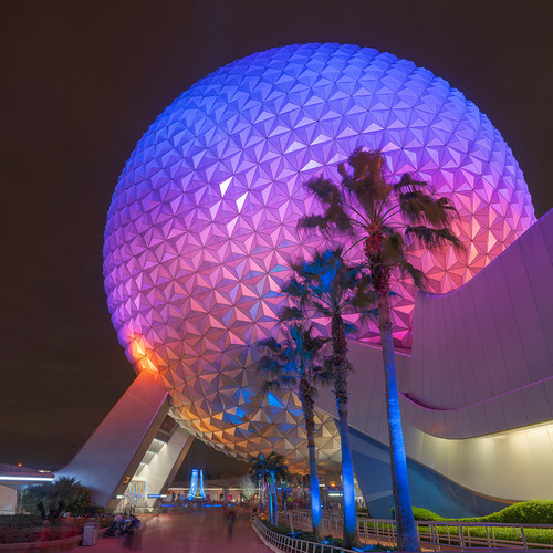 Spaceship earth and palm trees at night usvjsw