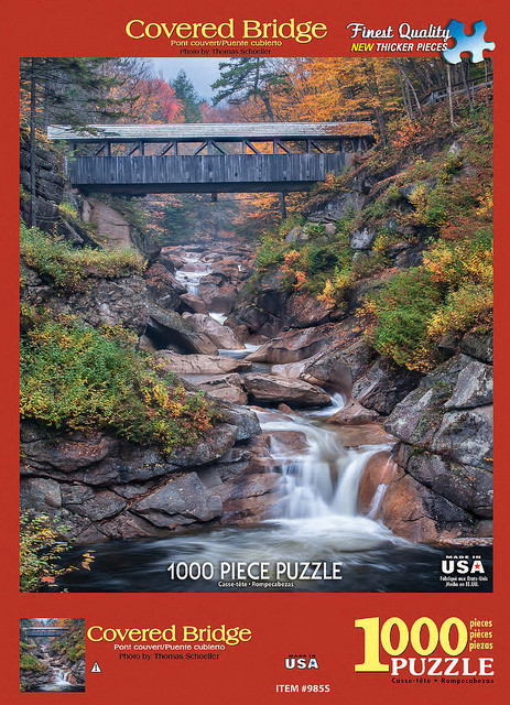 Thom Schoeller's New Hampshire covered bridge published by White mountain Puzzles, Inc. an all-time best Selling puzzle