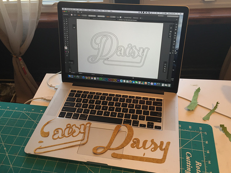 Jenny Goring uses Adobe Illustrator to lay out and alter her text and create a pattern to cut out using the Silhouette Cameo cutter.