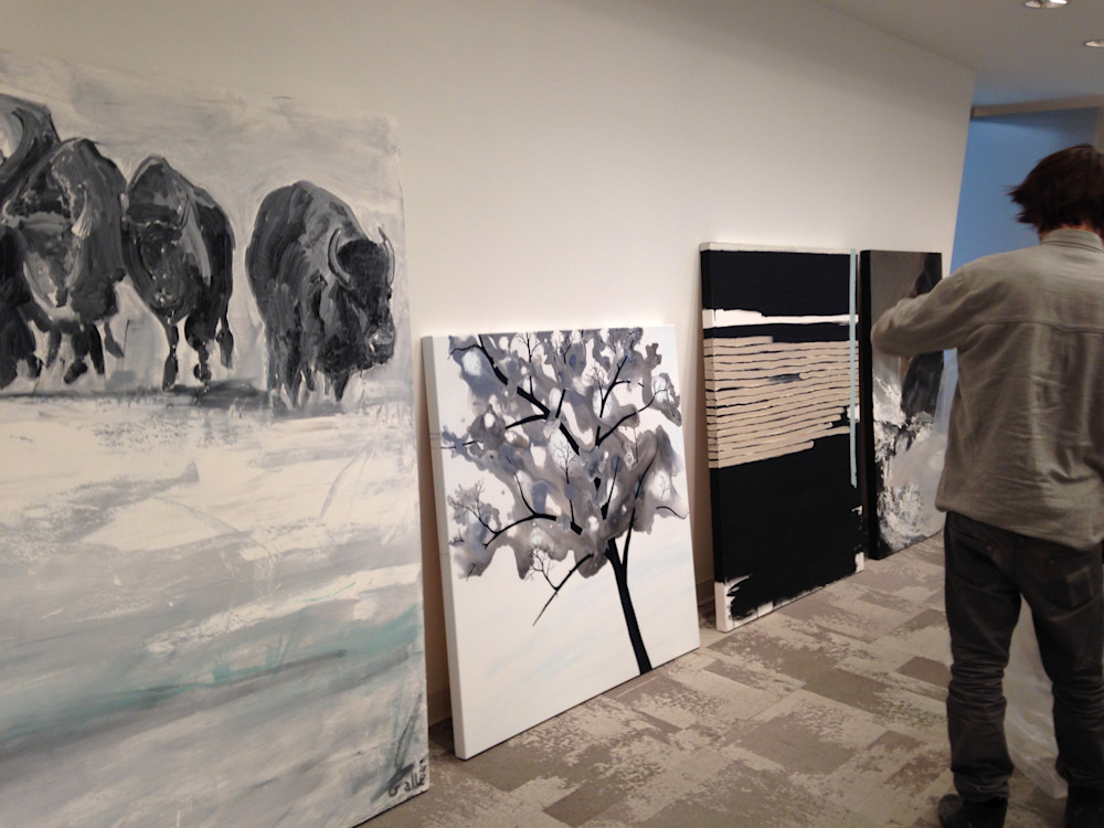 Artwork Installers hard at work at Sotheby's Realty Canada Gallery