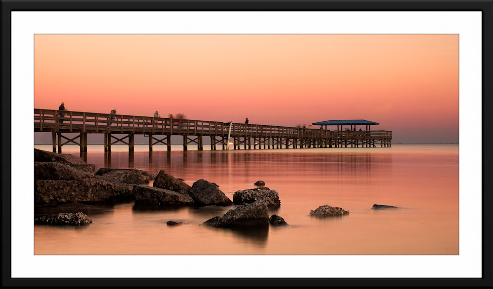 A framed and matted photograph of the Safety Harbor Pier named Afterglow and taken in Safety Harbor, Florida by local landscape photographer Andrew Vernon