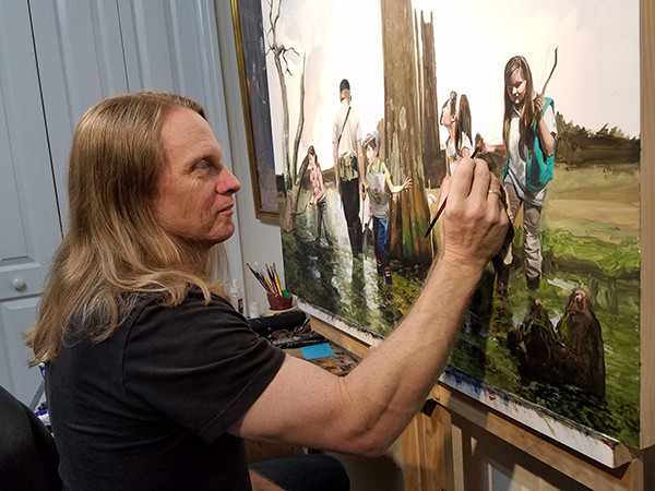"Florida artist Kevin Grass is roughing in the beginning of his ""Expedition"" painting with children exploring a nature preserve, not playing video games."