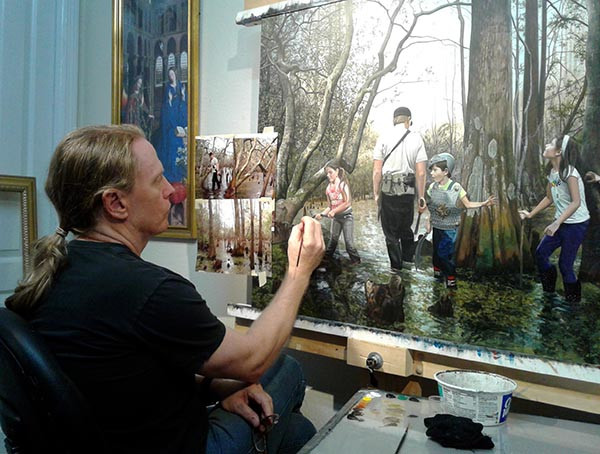 "Florida artist Kevin Grass working on his ""Expedition"" painting."