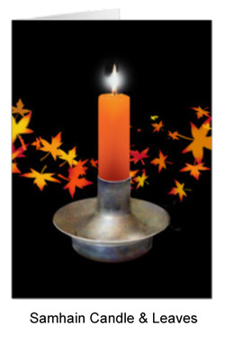 Orange candle with autumn leaves for Samhain