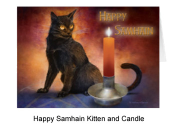 Black kitten with orange candle for Samhain