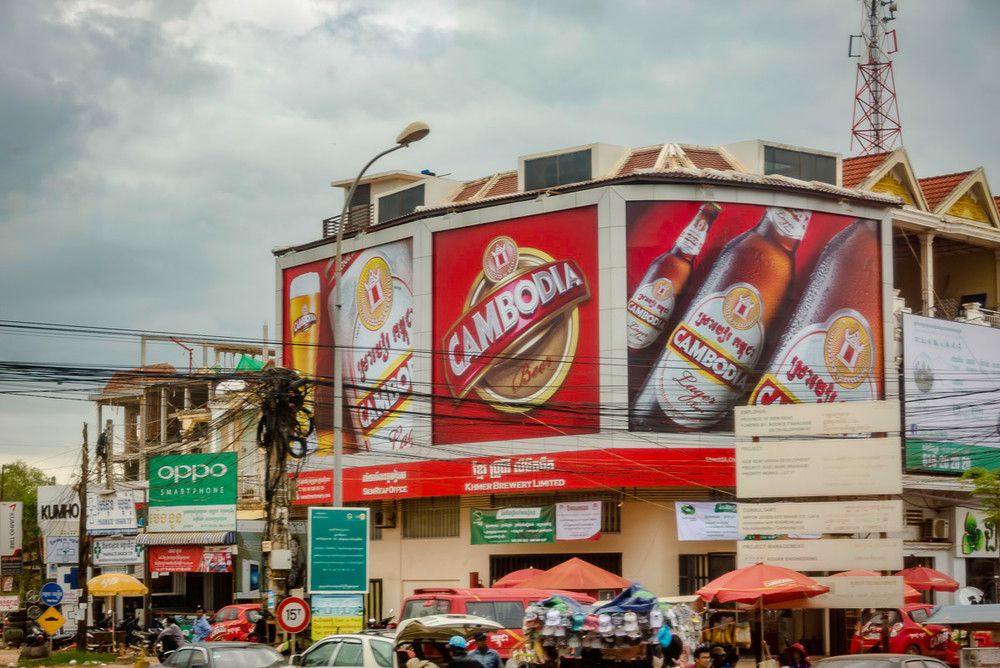 A photo of a billboard in Cambodia advertising Cambodian beer