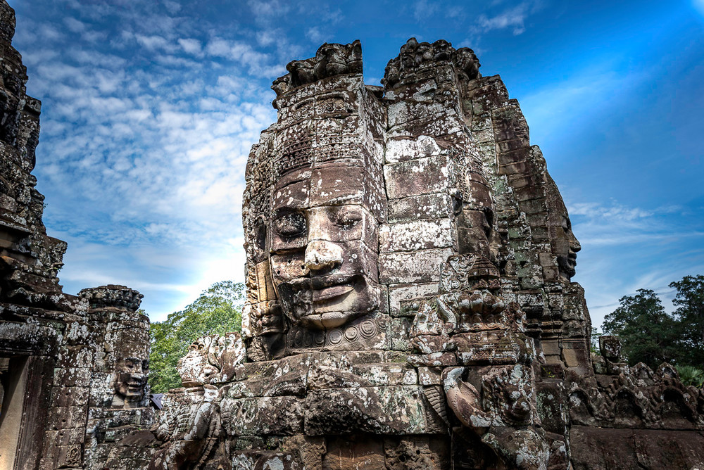 One of the famous faces carved in the rock at Bayon Temple at Angkor Wat in Cambodia