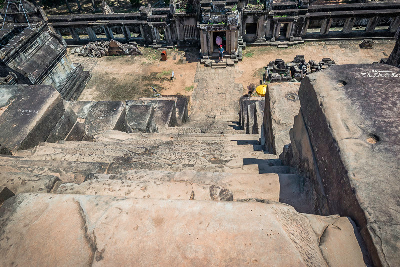 View looking down a steep set of Temple Stairs in Angkor Wat city