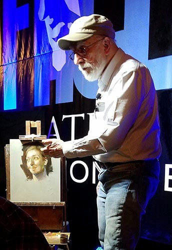 Max Ginsburg during a portrait painting demonstration at the FACE convention in Miami, November 2017.