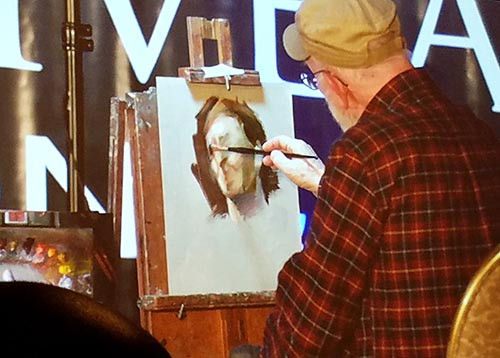 Artist Max Ginsburg giving a painting demonstration.