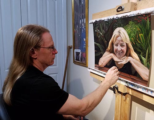 Florida realism artist Kevin Grass painting a portrait of his wife as a Christmas present on Thanksgiving Day 2017.