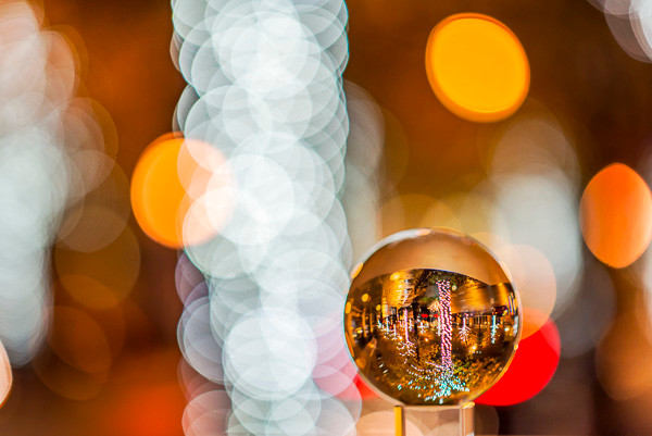 A mini prism globe reflects the Christmas lights on Peachtree Street