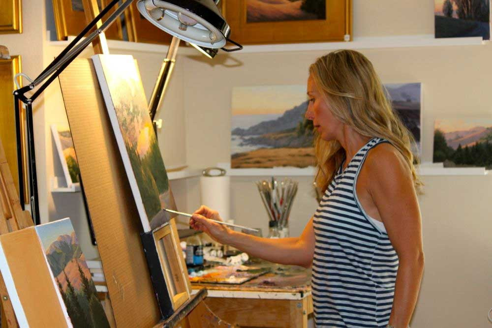 Terry Painting at her easel