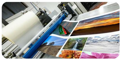 lots of custom canvas prints on a printer