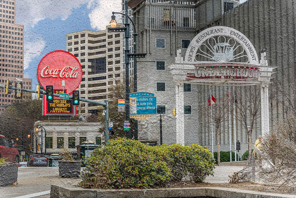 A photo of one of the Underground signs with the Coke sign in the background. A texture from the surrounding area was photographed and added to the photo