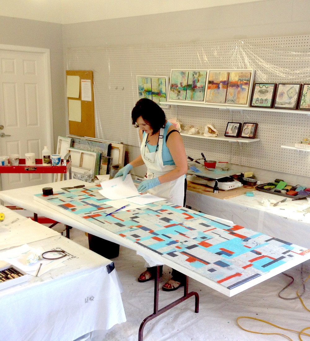 Artist Shirley Williams working in her studio