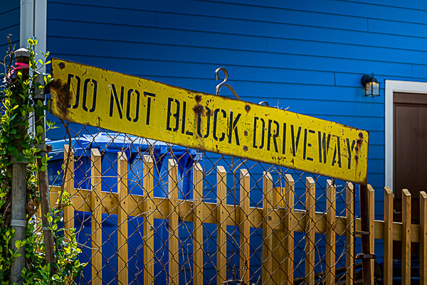 "Photo of a sign that says, ""Do not block driveway."""