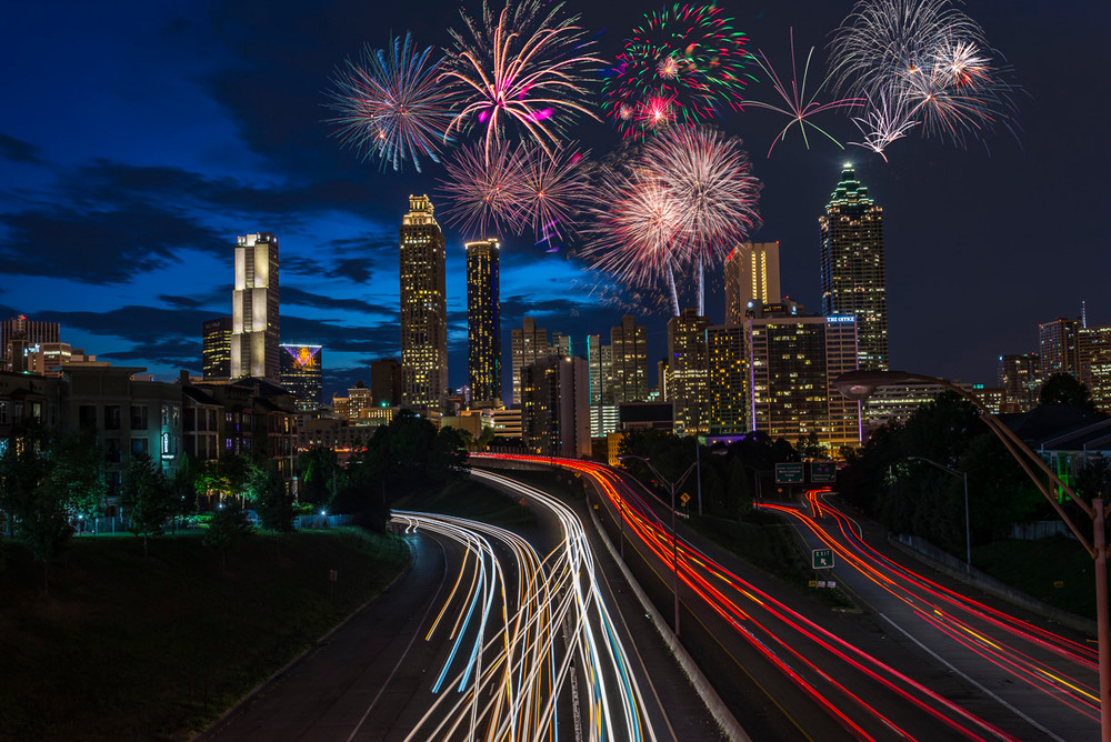 Fireworks over the Atlanta skyline as seen from the Jackson Street Bridge
