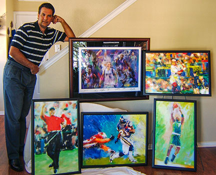 Sports artist Mark Trubisky standing with his sports art displayed