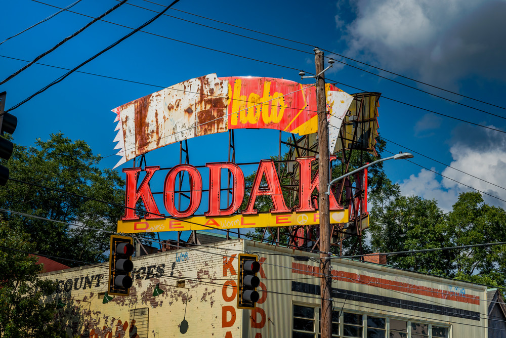 Wires and telephone poles surround the old Kodak sign on Ponce de Leon Ave.