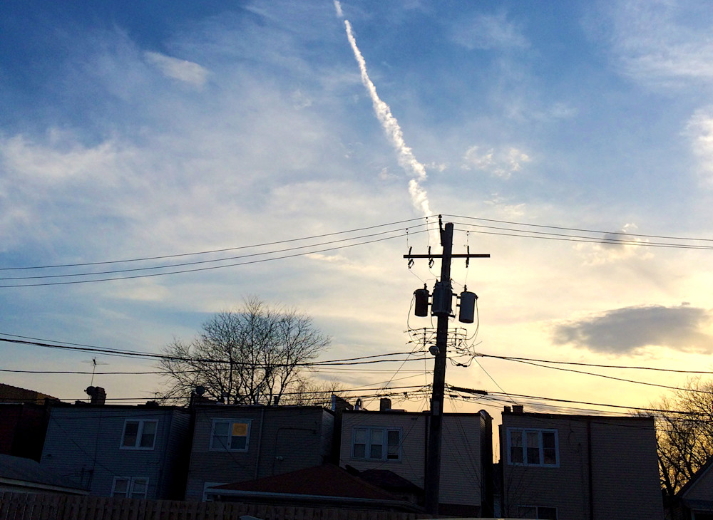 Jet Trail with power pole photograph