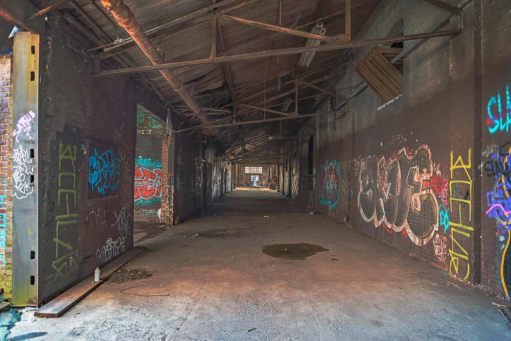 An abandoned train-repair yard building