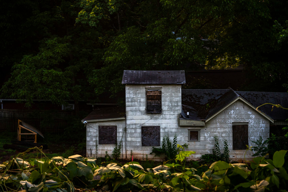 An old boarded-up house on the edge of the Beltline