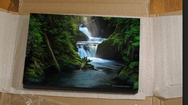 opening packaged styrene mounted prints