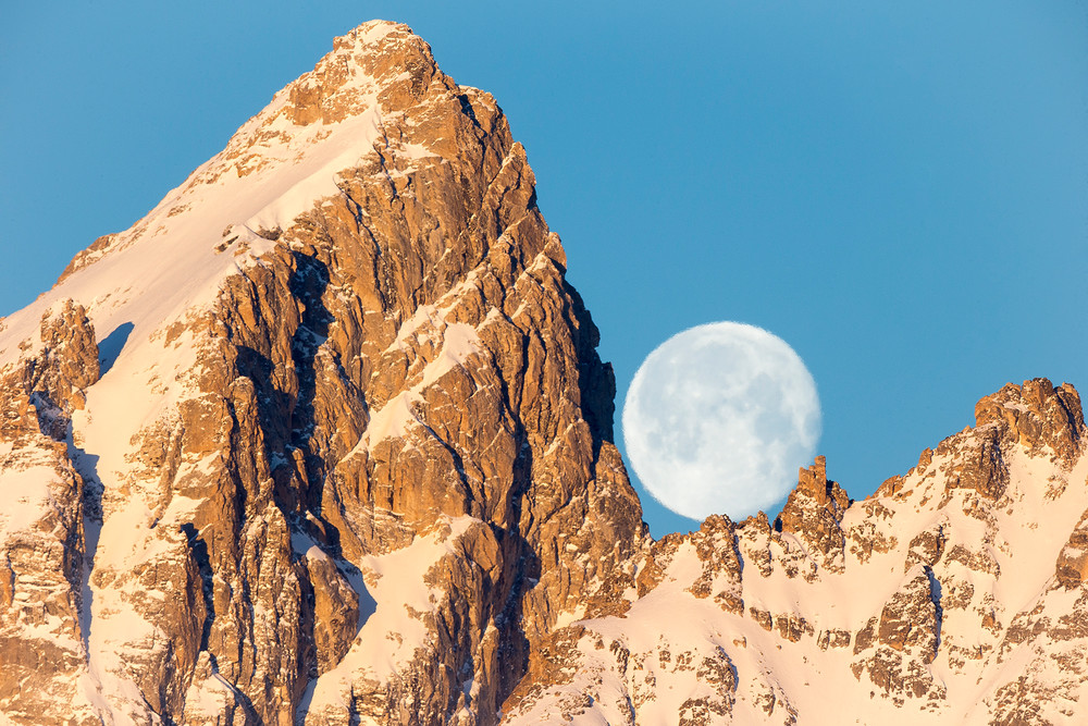 Grand Teton mountain and full moon