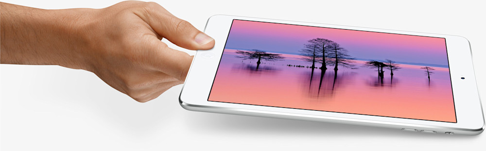 Apple iPad Mini With Photograph by Robbie George Photography