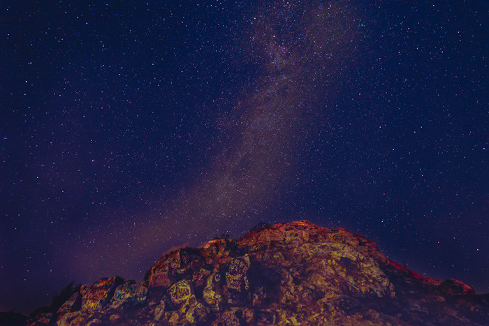 The Milky Way over a graffiti mountain