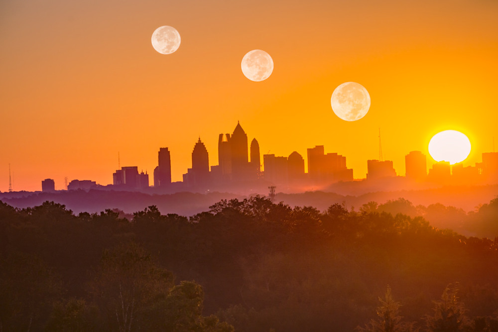 A fine-art composite photo of the sun and moon rising over the City of Atlanta